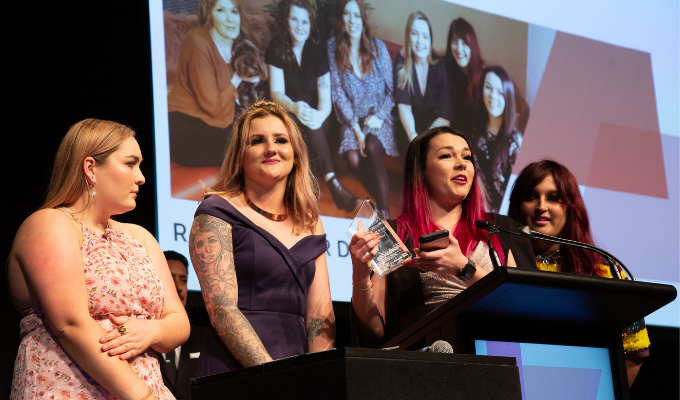 The Reds Hairdressing team collecting the Excellence in Marketing award in 2019.